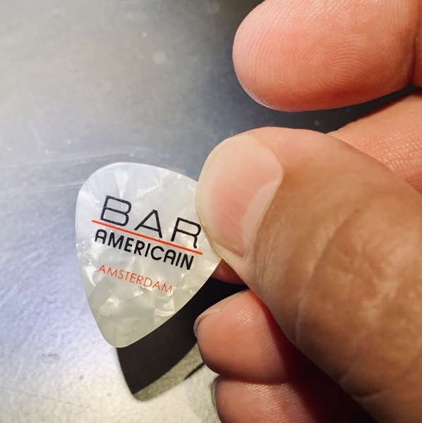 Gordon Meyer holding a guitar pick